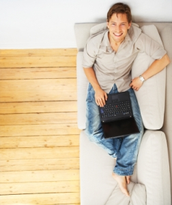 Young man relaxing with laptop
